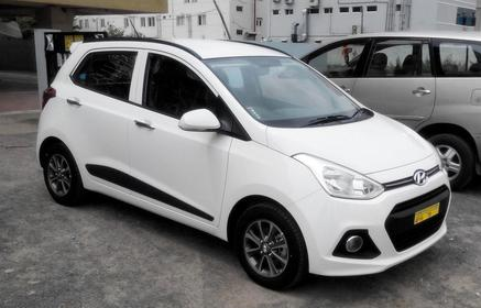 Slider_white-hyundai-grand-i10-official-review-right-side